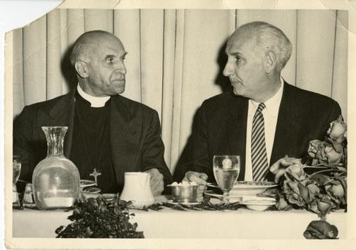 Alan Guttmacher with a priest
