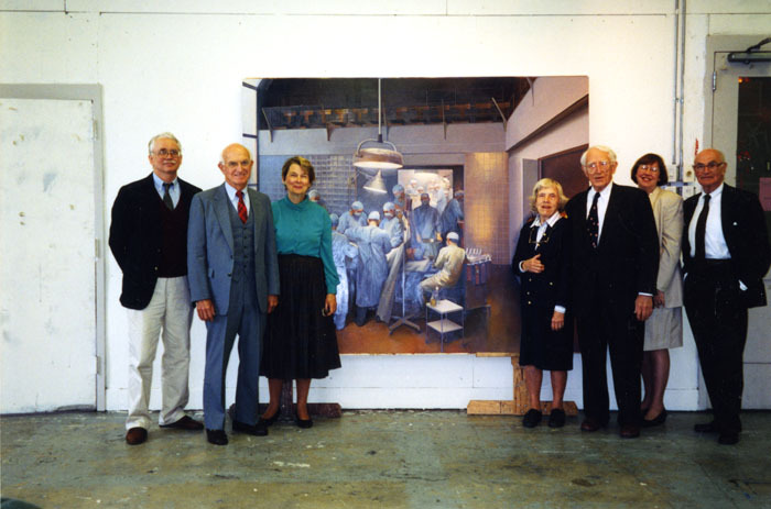 """Joseph Murray standing beside the painting """"The First Successful Kidney Transplantation"""""""