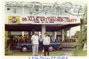 Alan Guttmacher, with wife Leonore, and a Fillipino colleague