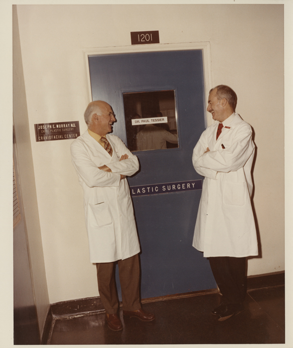 Dr. Murray and Dr. Tessier standing in front of the Plastic Surgery Unit at Children's Hospital