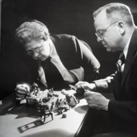 Photograph of Frances G. Lee and Alan R. Moritz working on furnishing for the Nutshell Studies of Unexplained Death, circa 1948.<br />