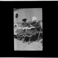 Two women, eating on deck