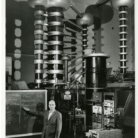 Lauriston Sale Taylor in a high voltage laboratory during the making of a movie on radiation protection