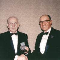 Dr. Cannon presenting an honorary award to Dr. Brown