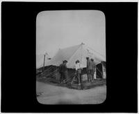 Men inspect a tent