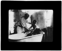 Patient being helped in a bath